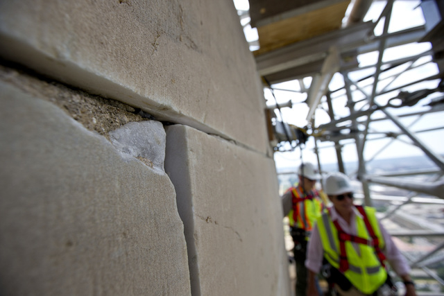 A damaged stone on the Washington Monument is shown June 2, 2013, at the 491-foot level of the scaffolding surrounding the monument, in Washington. The monument, which sustained damage from an ear ...