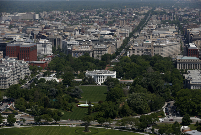 The South Lawn and the White House are seen from the 500-foot level of the Washington Monument in Washington on Monday, May 12, 2014, as it reopens. The monument, which sustained damage from an ea ...