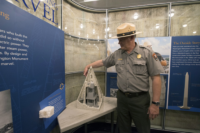 Bob Vogel, superintendent of National Mall and Memorial Parks, points out the location of a repaired crack on a scale model in a new exhibit inside the Washington Monument on Saturday, May 10, 201 ...