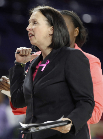 This Wednesday, Feb. 26, 2014 photo shows Ginny Doyle, University of Richmond associate coach, during a game against Virginia Commonwealth University in the Robins Center in Richmond, Va. A univer ...