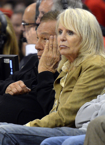 FILE - In this May 19, 2012, file photo, Los Angeles Clippers owner Donald Sterling, left, and his wife Rochelle watch during the second half in Game 3 of an NBA basketball playoffs Western Confer ...