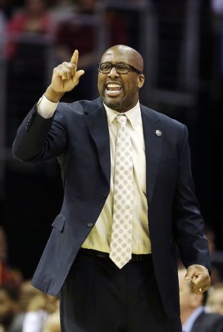 In this April 5, 2014 photo, Cleveland Cavaliers head coach Mike Brown yells at his team during an NBA basketball game against the Charlotte Bobcats in Cleveland. On Monday, May 12, 2014, the Cava ...