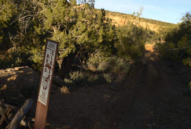 In this April 26, 2014 photo, signs posted from 2007 detail travel restrictions and no motorized use throughout Recapture Canyon in Utah. The Bureau of Land Management  closed it to motorized use  ...