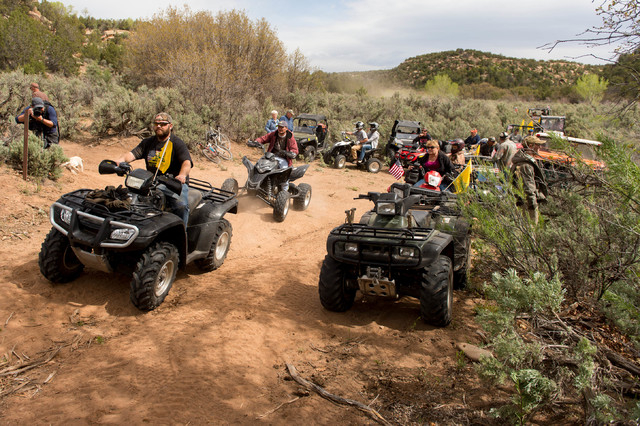 ATV riders cross into a restricted area of Recapture Canyon, north of Blanding, Utah, on Saturday, May 10, 2014, in a protest against what demonstrators call the federal government's overreaching  ...