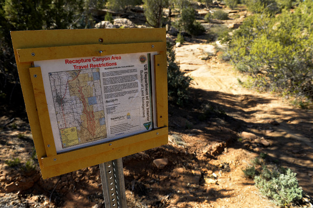 This April 26, 2014 photo shows signs posted from 2007 detail travel restrictions and no motorized use throughout Recapture Canyon in Utah. The Bureau of Land Management  closed it to motorized us ...