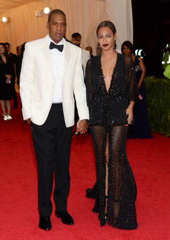 "This May 5, 2014 file photo shows Jay Z, left, and Beyonce at The Metropolitan Museum of Art's Costume Institute benefit gala celebrating ""Charles James: Beyond Fashion"" in New York. The Standard  ..."