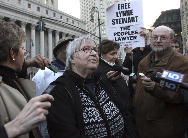 In this Nov. 17, 2009, file photo, Lynne Stewart, center, is surrounded by supporters and reporters in New York after a federal appeals court in New York City said a judge who sentenced Stewart to ...