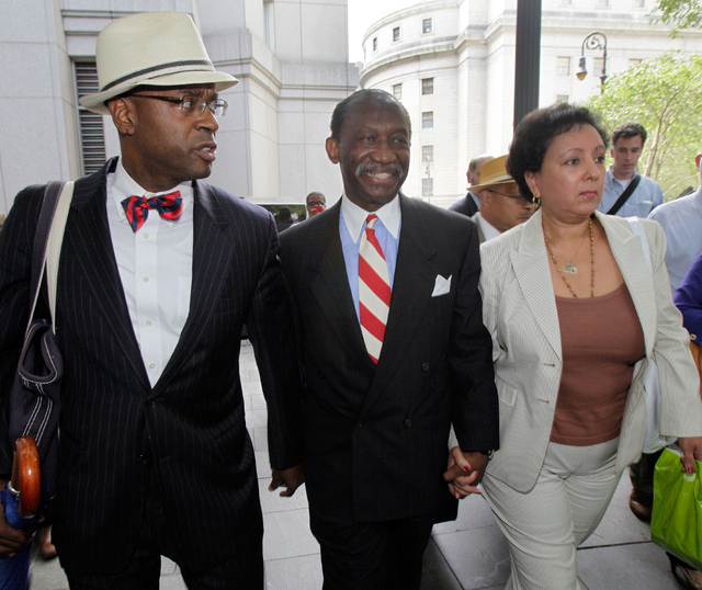 In this July 26, 2012, file photo, attorney Anthony Ricco, left, walks with Larry Seabrook, center, a New York City councilman and Seabrook's wife Maria Diaz, as they leave Federal Court in New Yo ...