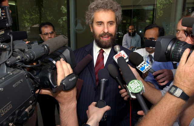 In this May 29, 2003, file photo, attorney Stanley Cohen, center, speaks to reporters on the steps of the Federal Courthouse in Portland, Oregon after his client, Mohamed Kariye, who pleaded guilt ...