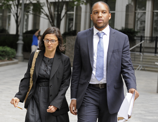 In this Oct. 6, 2012, file photo, federal defense attorneys Sabrina Shroff, left, and Jerrod Thompson Hicks exit Manhattan federal court, in New York where they were representing Mustafa Kamel Mus ...