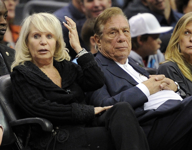 In this Nov. 12, 2010, file photo, Los Angeles Clippers owner Donald T. Sterling, right, sits with his wife Rochelle during the Clippers NBA basketball game against the Detroit Pistons in Los Ange ...