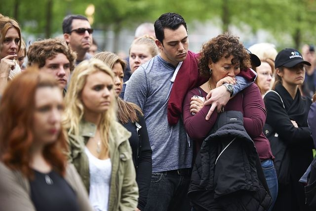 Visitors gather on the plaza of the National September 11 Memorial to watch a telecast of the dedication ceremony for the National September 11 Memorial Museum in New York, Thursday, May 15, 2014. ...