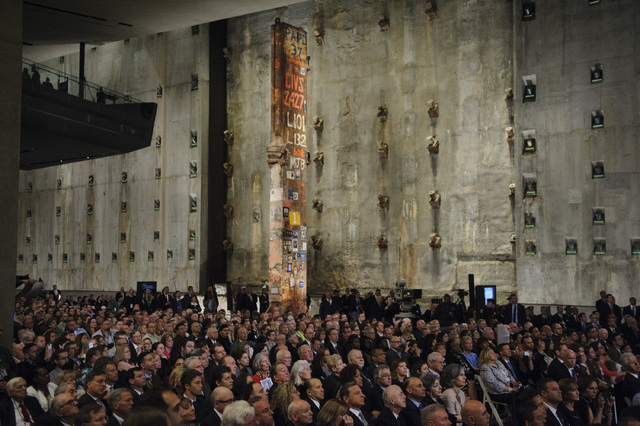 People attend the Dedication Ceremony of the National September 11 Memorial Museum in the museum's Foundation Hall on Thursday, May 15, 2014 in New York.  (AP Photo/Newsday, Charles Eckert, Pool)