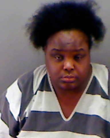 This undated booking photo provided by the Longview Police Department shows Charity Johnson. Authorities say Johnson,  34, posed as a teenager to enroll as a sophomore at a private Texas high scho ...