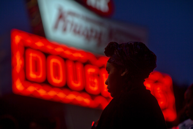 Burger King employee Keisha King, 23, stands during a protest outside a Krispy Kreme store, Thursday, May 15, 2014, in Atlanta. Calling for higher pay and the right to form a union without retalia ...
