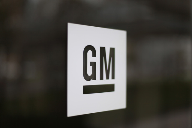 This Friday, May 16 2014 photo shows the General Motors logo at the company's world headquarters in Detroit. U.S. safety regulators fined General Motors a record $35 million Friday for taking at l ...