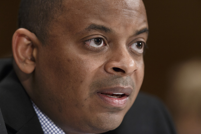 FILE - This March 14, 2014 file photo shows Transportation Secretary Anthony Foxx on Capitol Hill in Washington.  U.S. safety regulators have fined General Motors $35 million for delays in recalli ...