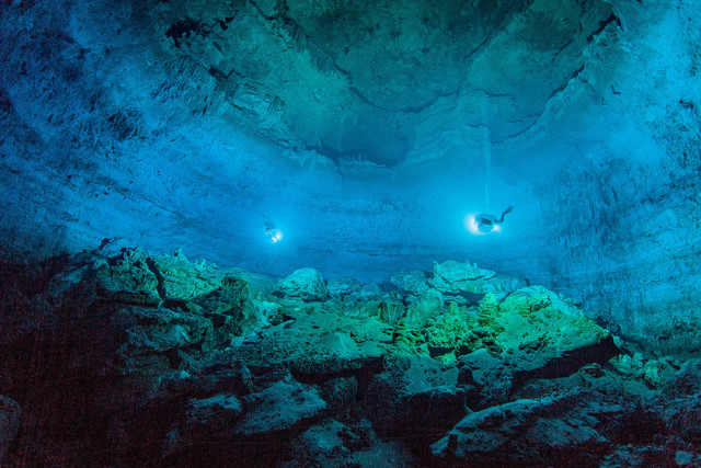 """Divers use lights in May to illuminate Hoyo Negro, an underwater cave in Mexico's Yucatan Peninsula where the remains of """"Naia,"""" a teenage girl who lived 12,000 to 13,000 years earlier, were found ..."""