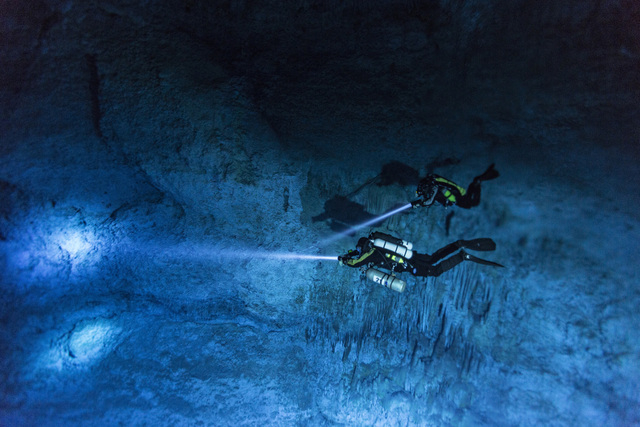 """Divers make their way toward Hoyo Negro in 2013, an underwater cave in Mexico's Yucatan Peninsula where the remains of """"Naia,"""" a teenage girl who lived 12,000 to 13,000 years earlier, were found.  ..."""