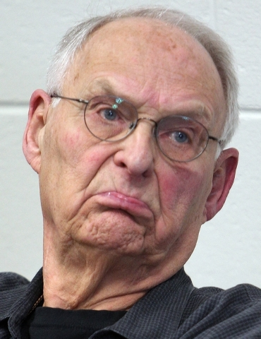 Wolfeboro Police Commissioner Robert Copeland listens Thursday, May 15, 2014 in Wolfeboro, N.H. as town residents ask for his resignation after being overheard calling President Barack Obama the N ...