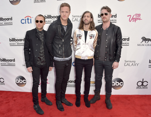 Ben McKee, from left, Dan Reynolds, Wayne Sermon and Daniel Platzman, of the musical group Imagine Dragons, arrive at the Billboard Music Awards at the MGM Grand Garden Arena on Sunday, May 18, 20 ...