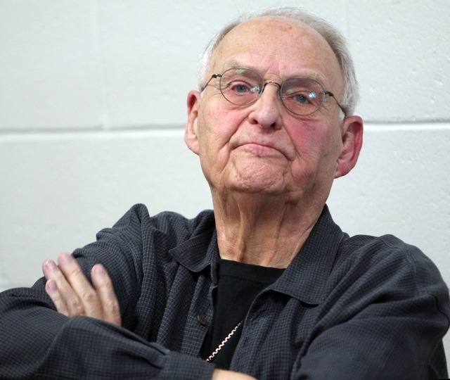Wolfeboro Police Commissioner Robert Copeland listens Thursday May 15, 2014 in Wolfeboro, N.H. as town residents ask for his resignation after being overheard calling President Barack Obama the N- ...