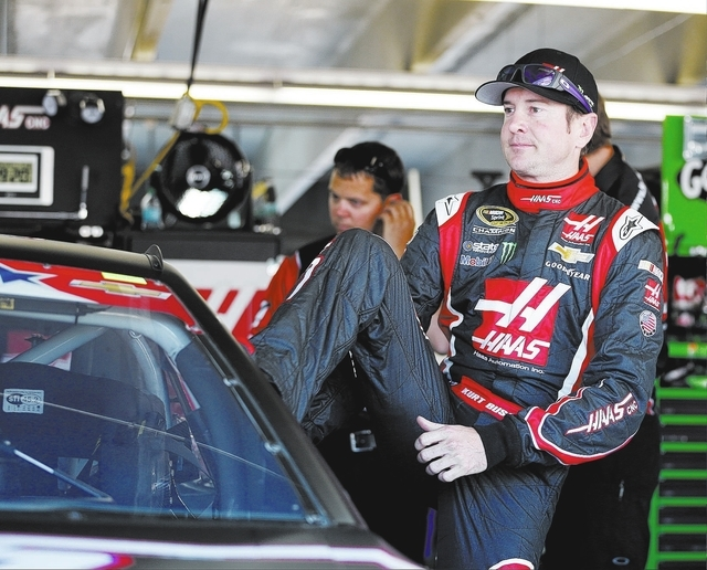 Kurt Busch climbs into his car before practice for Sunday's NASCAR Sprint Cup series Coca-Cola 600 auto race at Charlotte Motor Speedway in Concord, N.C., Saturday, May 24, 2014. (AP Photo/Chris K ...