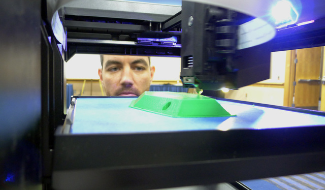 Michael Fieldson , the civilian project manager for the US Special Operations Command's Tactical Assault Light Operator Suit at MacDill Air Force Base, looks at a 3D printer during a trade show in ...