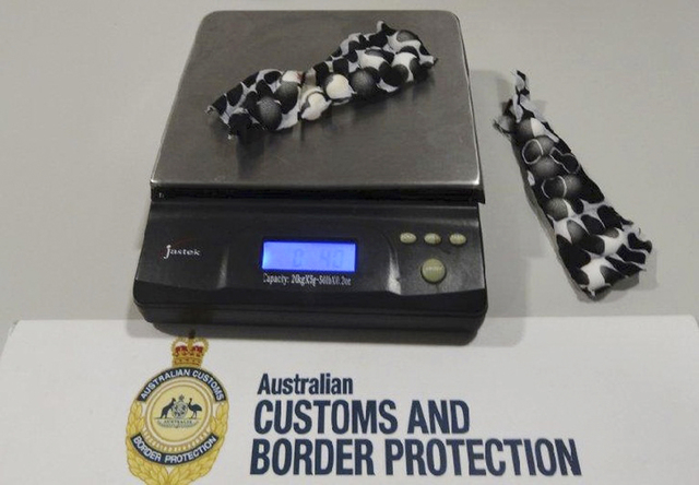 This Tuesday, May 20, 2014 photo provided by Australian Customs and Boarder Protection Service shows small bird eggs hidden in strips of fabric which were removed from a traveler at Sydney interna ...