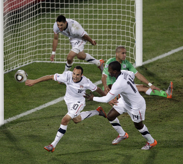 Landon Donovan, front left, of the United States, celebrates after scoring a goal with fellow team members Clint Dempsey, back left, and  Edson Buddle, front right, during a World Cup group C socc ...