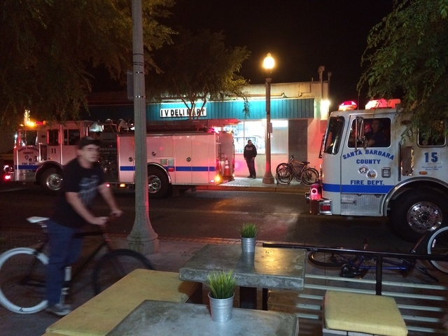 Fire trucks are parked outside the IV Deli Mart on Pardell Road in Isla Vista, Calif., Friday, May 23, 2014, after a drive-by shooter went on a rampage near a Santa Barbara university campus that  ...