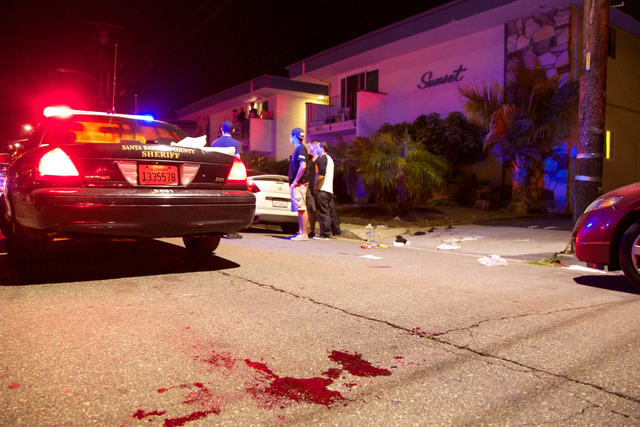 Police investigate the scene of a drive-by shooting that left seven people dead, including the attacker, and others wounded on Friday, May 23, 2014, in Isla Vista, Calif. Alan Shifman an attorney  ...