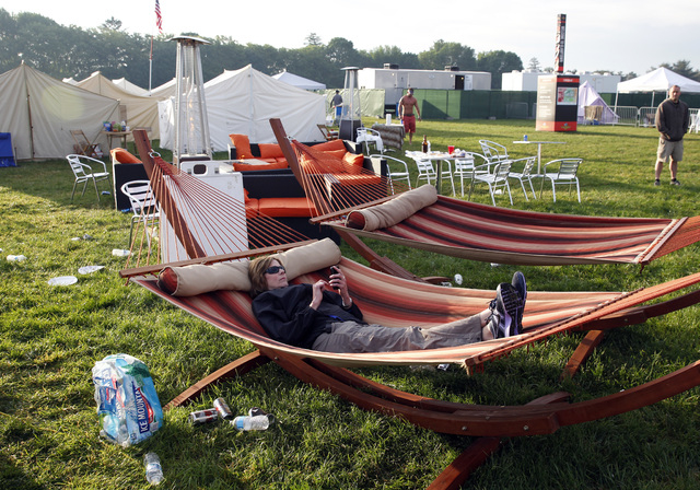 "Mary Milz, of Indianapolis, lies in a hammock, in the ""Glamping"" area in the infield at the Indianapolis Motor Speedway before the start of Indianapolis 500 IndyCar auto race in Indianap ..."