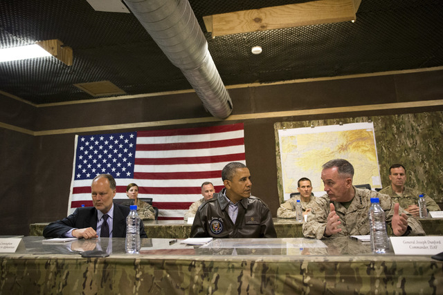 President Barack Obama, center, is briefed by Marine General Joseph Dunford, commander of the US-led International Security Assistance Force (ISAF), right, and US Ambassador to Afghanistan James C ...
