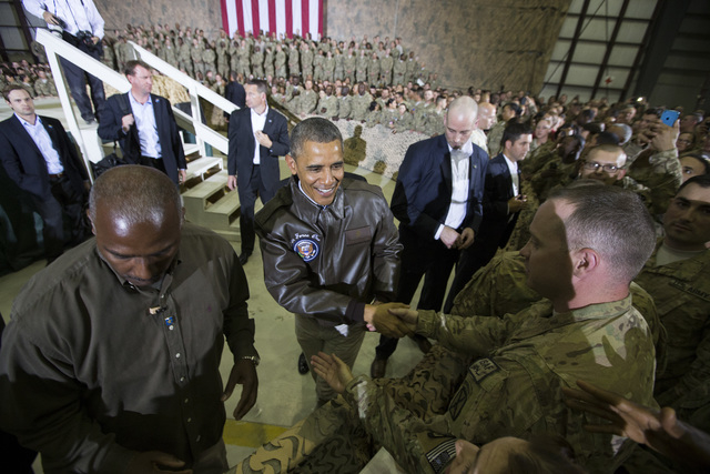 President Barack Obama shakes hands at a troop rally at Bagram Air Field, north of Kabul, Afghanistan, during an unannounced visit, on Sunday, May 25, 2014. (AP Photo/ Evan Vucci)