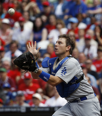 Los Angeles Dodgers catcher A.J. Ellis catches a pop out by Philadelphia Phillies' Jimmy Rollins during the first inning of a baseball game, Saturday, May 24, 2014, in Philadelphia. (AP Photo/Matt ...