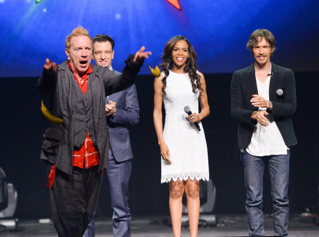 "In this April 4, 2014 file photo, from left, singer John Rotten Lydon throws bananas at the media, JC Chasez, Michelle Williams and Brandon Boyd look on, at the ""Jesus Christ Superstar"" arena spec ..."