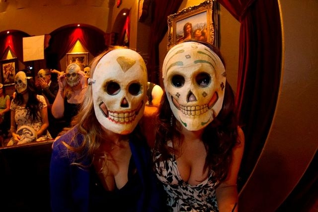 Guests pose for a photo during a Dia de los Muertos themed wedding performed by humanist celebrant Raul Martinez in Las Vegas in October 2012. (Special to View)