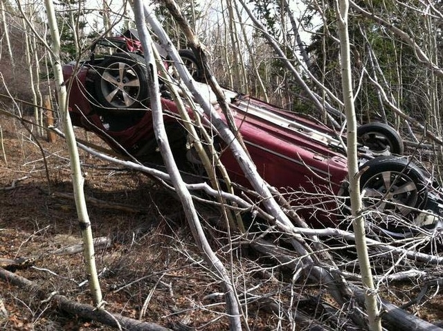 A woman from Highlands Ranch, Colo., was discovered in the wreckage of a car near Red Hills Pass in Park County. (Courtesy, Silverheels Towing and Recovery)