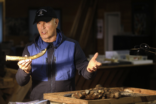 """Underseas explorer Barry Clifford holds the barrel of a partially crushed blunderbuss he salvaged from the wreck of pirate ship """"Whydah"""" during a video interview in Brewster, Mass., on Sept. 17, 2 ..."""