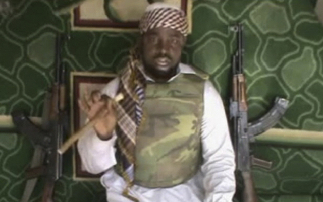 This file image made available from Wednesday, Jan. 10, 2012,  taken from video posted by Boko Haram sympathizers shows the leader of the radical Islamist sect Imam Abubakar Shekau. The Westgate m ...