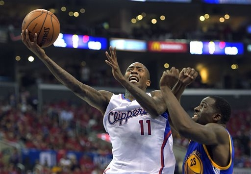 Los Angeles Clippers guard Jamal Crawford, left, goes up for a shot as Golden State Warriors forward Draymond Green defends during the first half in Game 7 of an opening-round NBA basketball playo ...