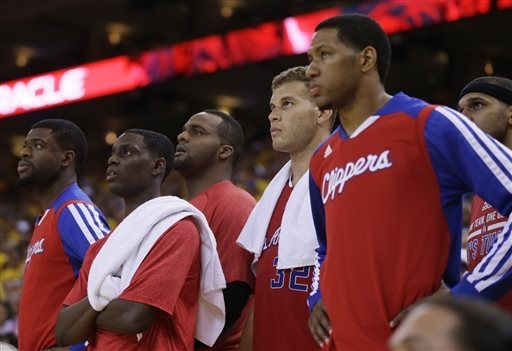 Members of the Los Angeles Clippers watch from the bench in the closing seconds of a loss to the Golden State Warriors during Game 6 of an opening-round NBA basketball playoff series on Thursday,  ...