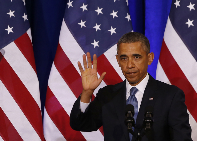 President Barack Obama waves to the audience after he spoke about National Security Agency (NSA) surveillance, at the Justice Department in Washington. Several of the key surveillance reforms unve ...