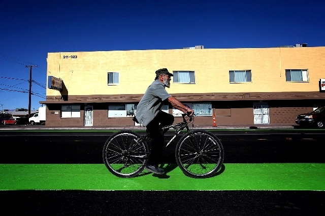 A bicyclist rides along a green bicycle lane on Ogden Avenue near Ninth Street in downtown Las Vegas. The more prominent bike lanes are part of the Downtown Pedestrian and Bike Improvement Project ...