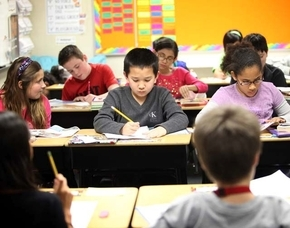 Fourth-graders Charles Ballesteros, 9, center, and Zayba Mitchell, 10, right, work in their portable classroom at Robert L. Forbuss Elementary School in Las Vegas. (Las Vegas Review-Journal)