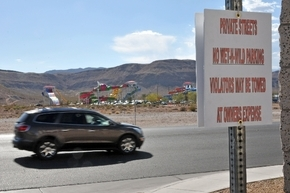 A sign posted in a neighborhood across Fort Apache Road from Wet 'n' Wild Las Vegas warns vehicles against unauthorized parking. Traffic on Fort Apache Road increased since the water park open ...