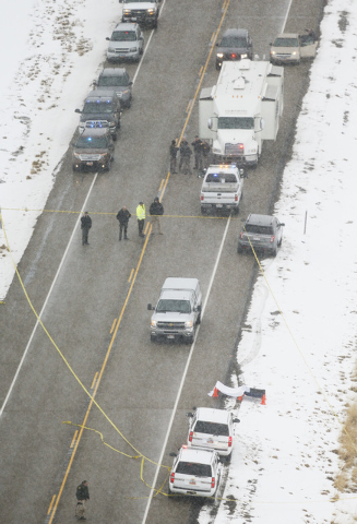 Law enforcement investigate the scene of an officer involved shooting on SR-73 in Eagle Mountain  Thursday, Jan. 30, 2014 that resulted in the death of a Utah County sheriff's deputy according to  ...