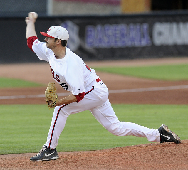 UNLV Rebels starting pitcher Kenny Oakley delivers against the San Diego State Aztecs in the first inning of the 2014 Mountain West Conference Baseball Championship game at Earl E. Wilson Stadium  ...