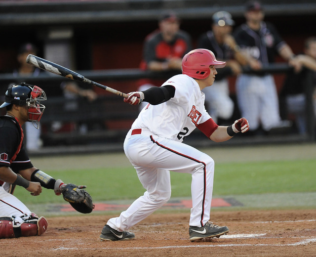 UNLV infielder A.J. Hernandez drives in a run in second inning of the 2014 Mountain West Conference Baseball Championship game between San Diego State Aztecs at Earl E. Wilson Stadium in Las Vegas ...
